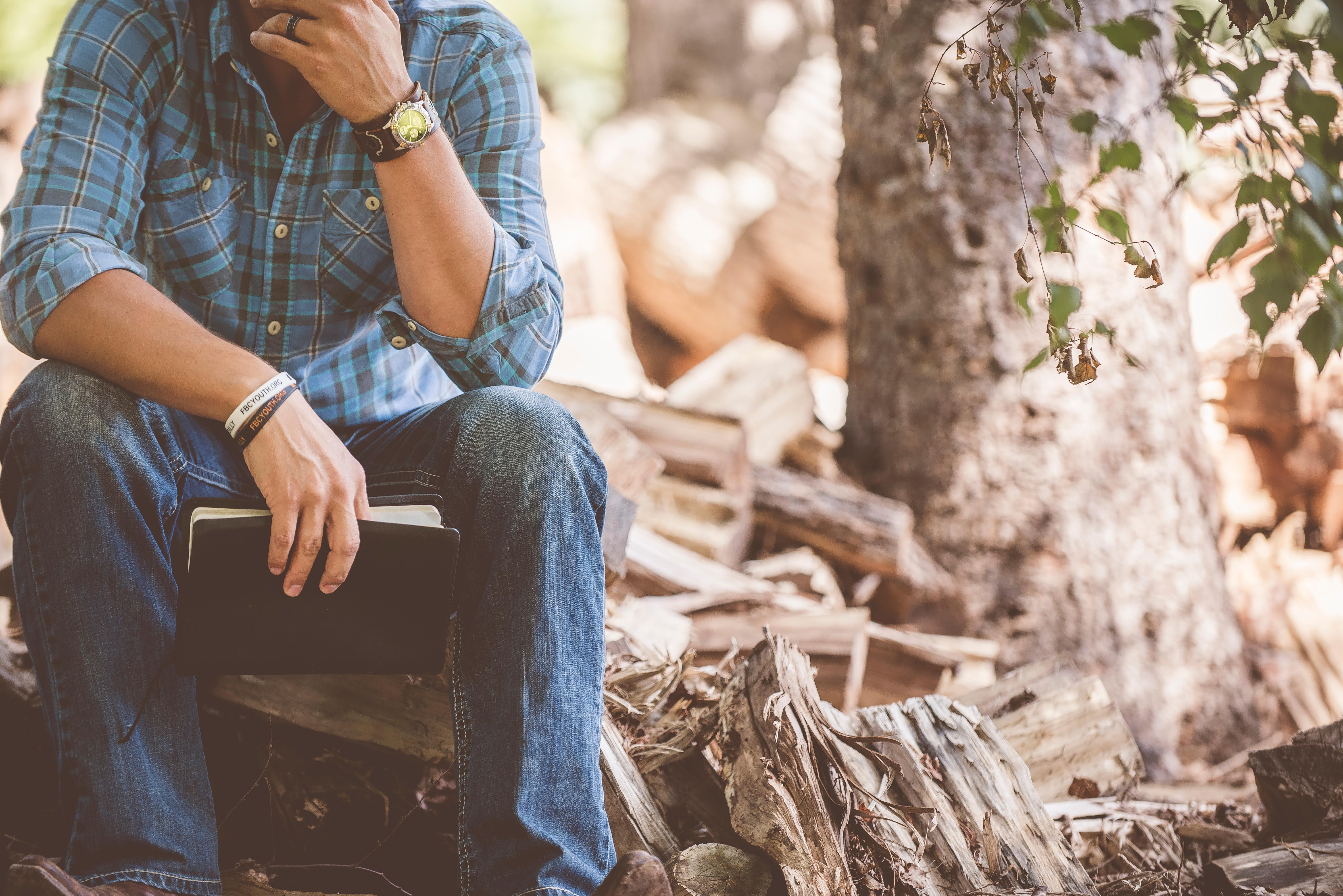 man on wood pile